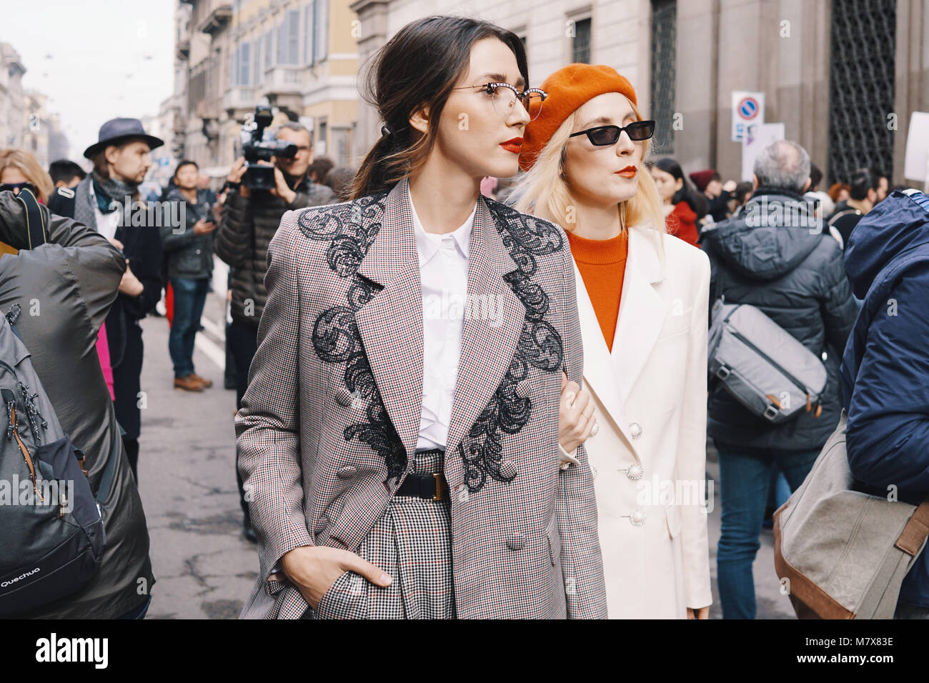 Milan, Italy - February 24, 2018: Fashion appearance of a fashionista with stylish clothing and accessories during - Stock Image