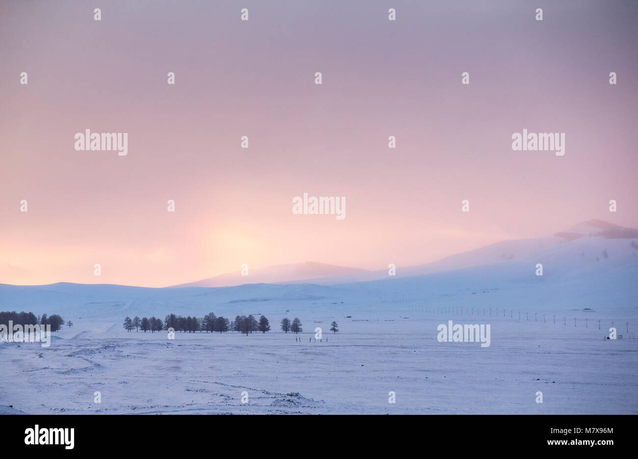 sunset in a snowy northern Mongolian landscape - Stock Image