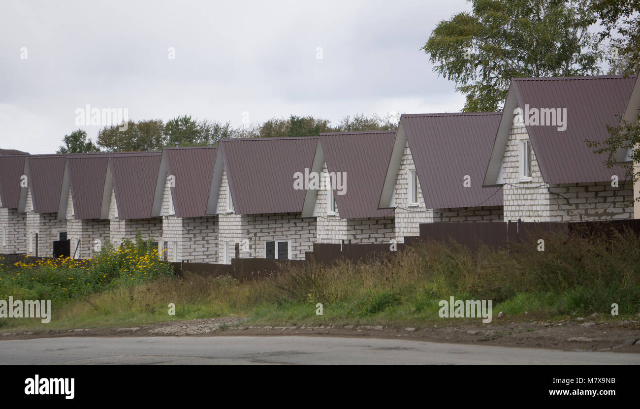 Identical row houses. Symbol for mass production in the building industry. - Stock Image