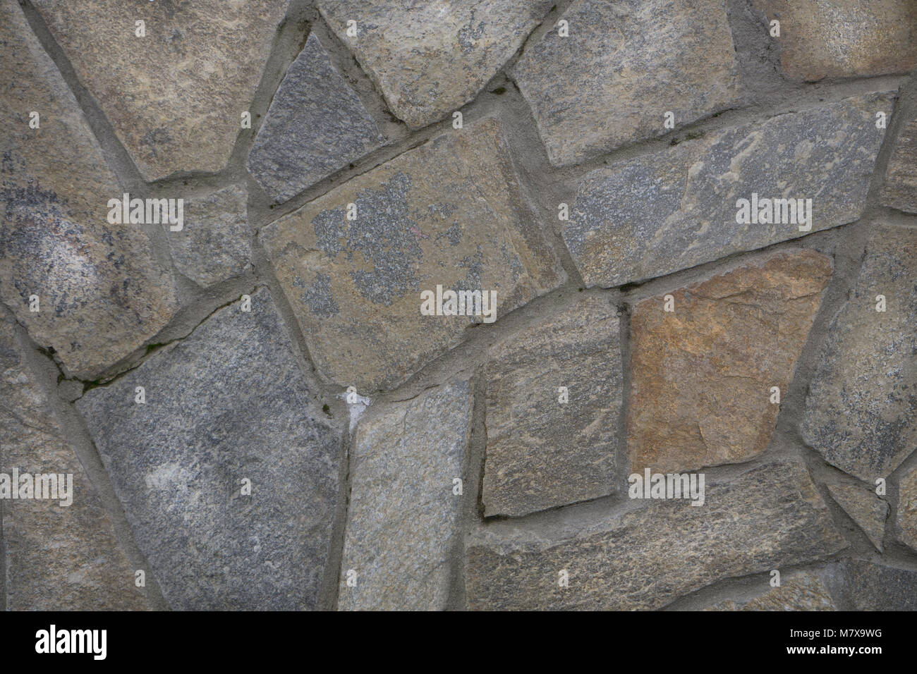 Stone wall texture,white stones in the park. Decorative background of stones, the texture of pebbles in different - Stock Image