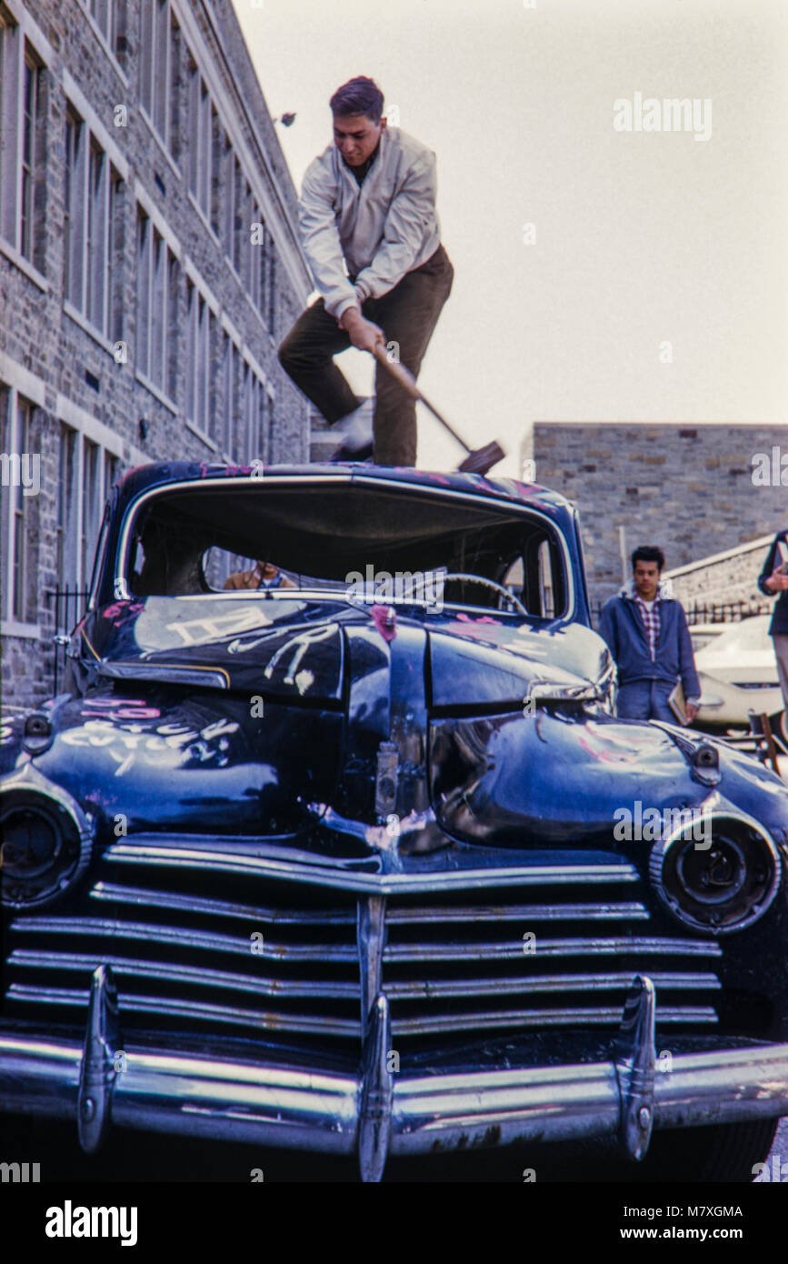 Spring Fair and students smashing up an old American car at Lower Merion High School, Montgomery County, Pennsylvania, - Stock Image