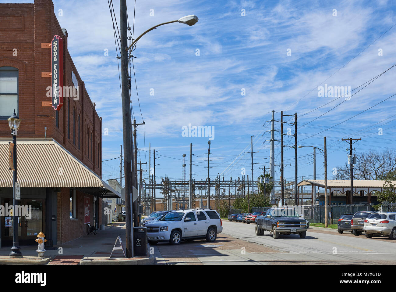 The Electrical Sub Station with all its Pylons downtown next to the Train Station at Rosenberg in Texas. - Stock Image