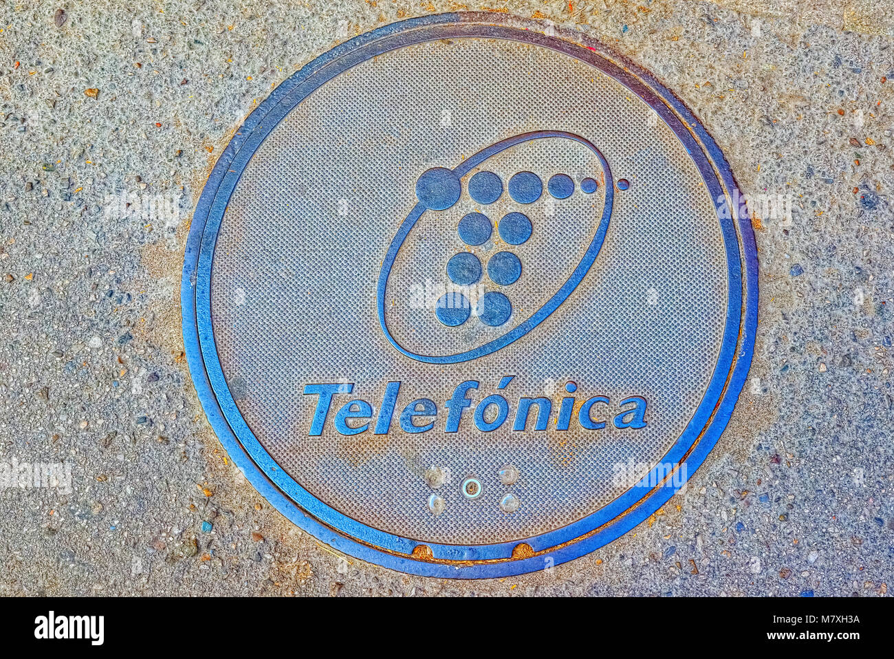 Seville, Slain- June 09, 2017 : Sewage telephone hatch with the inscription of the telecommunications company of - Stock Image