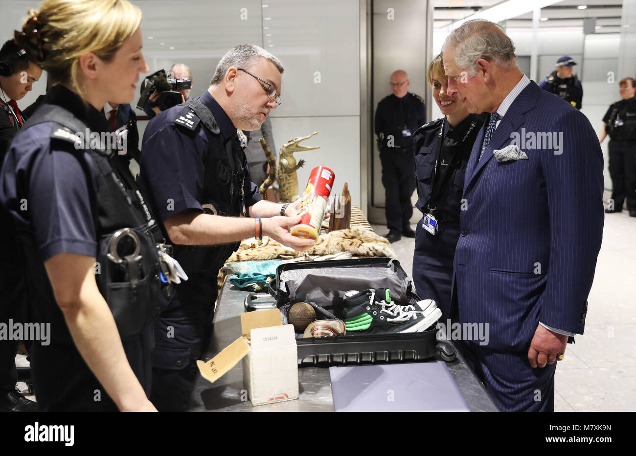 The Prince of Wales (right) is shown items of luggage that have been confiscated during inspections by customs officers - Stock Image