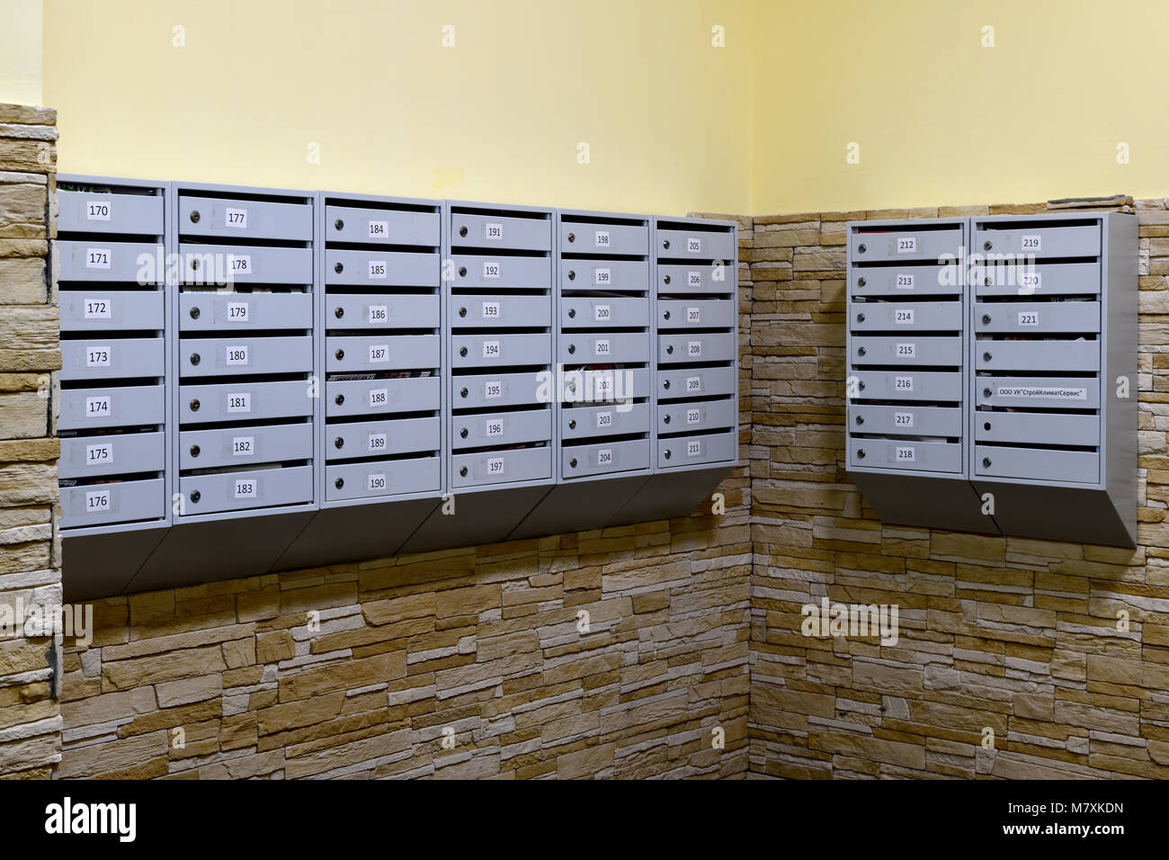 gray mailboxes in corridor of the apartment building Stock Photo ...