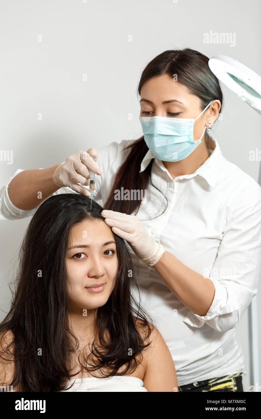 cosmetologist procedure of mesotherapy - Stock Image