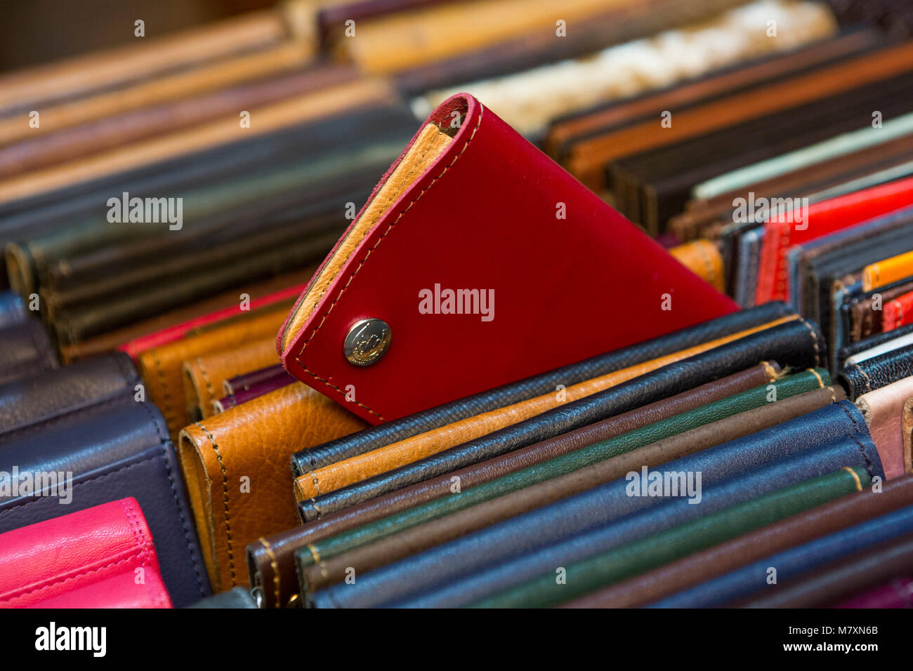 Selection of leather purses for sale. - Stock Image