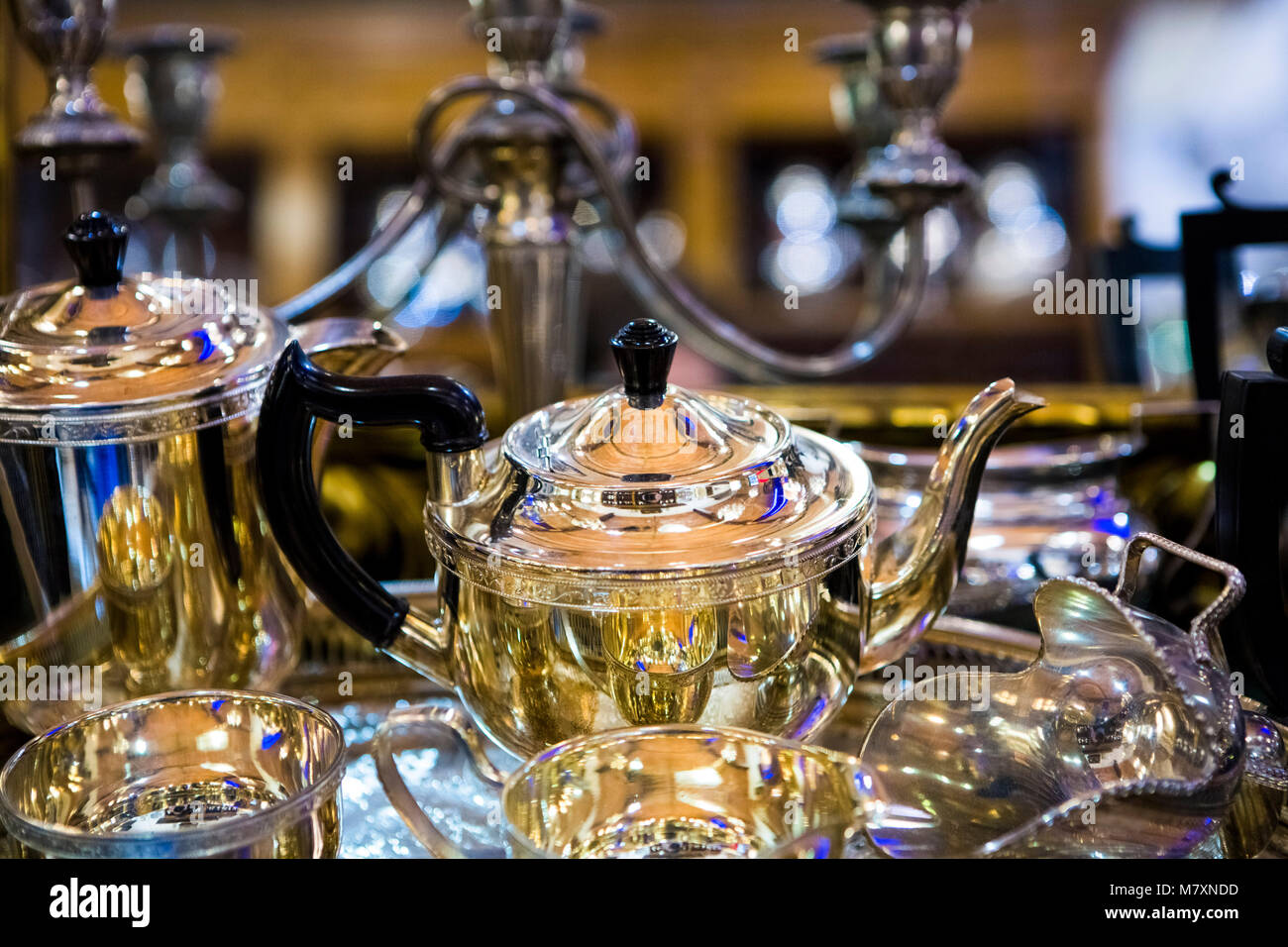 Vintage silver teaset in antiques store. - Stock Image