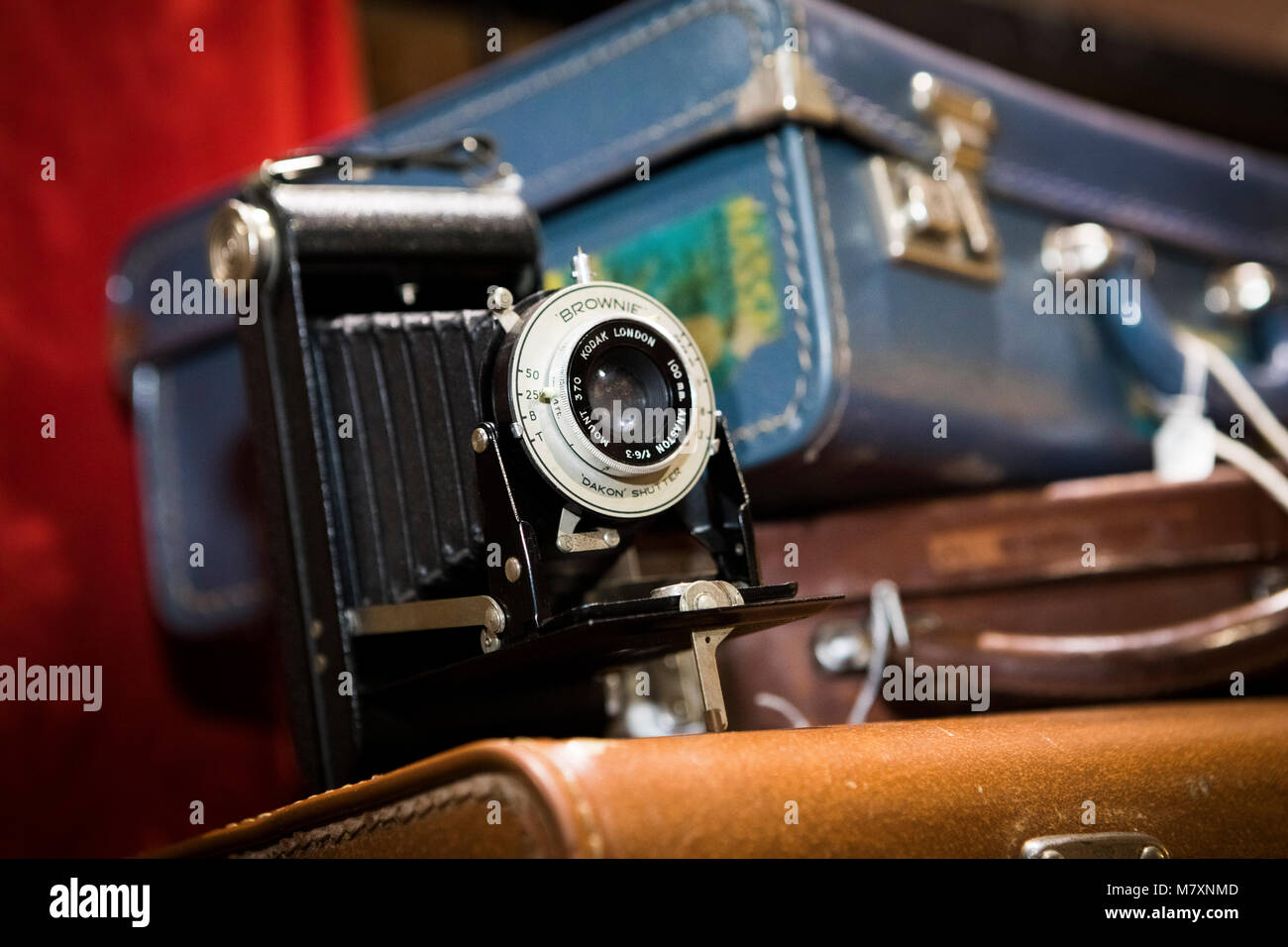 Vintage camera: Brownie, for sale with suitcases in vintage store. - Stock Image