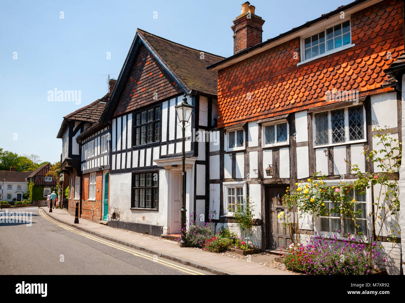 STEYNING, UK - JUN 6, 2013: Old town street with Tudor style timber frame houses - Stock Image