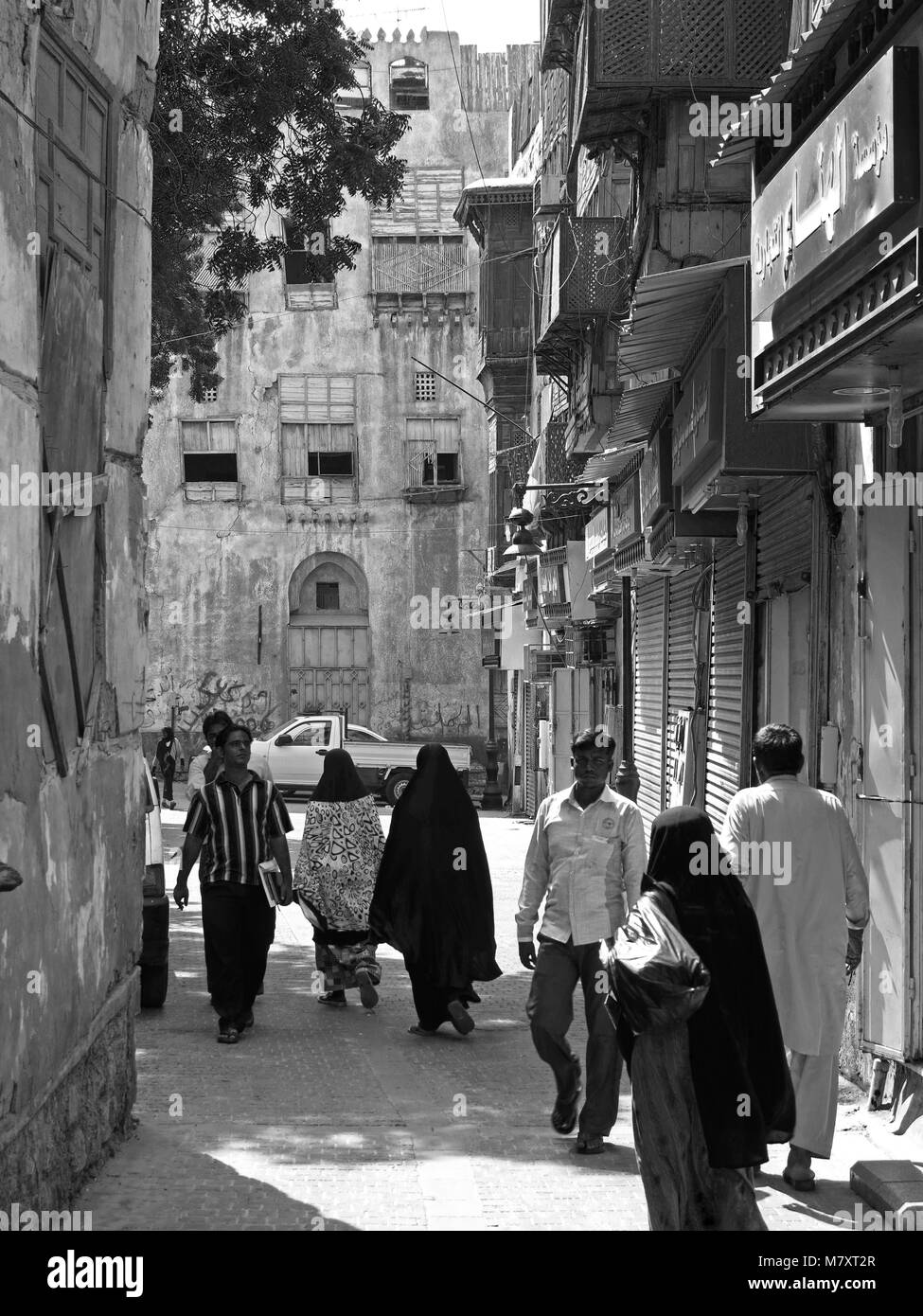 street life, architecture and impressing old houses with wooden bay windows and mashrabya in Al Balad, Jeddah, Saudi - Stock Image