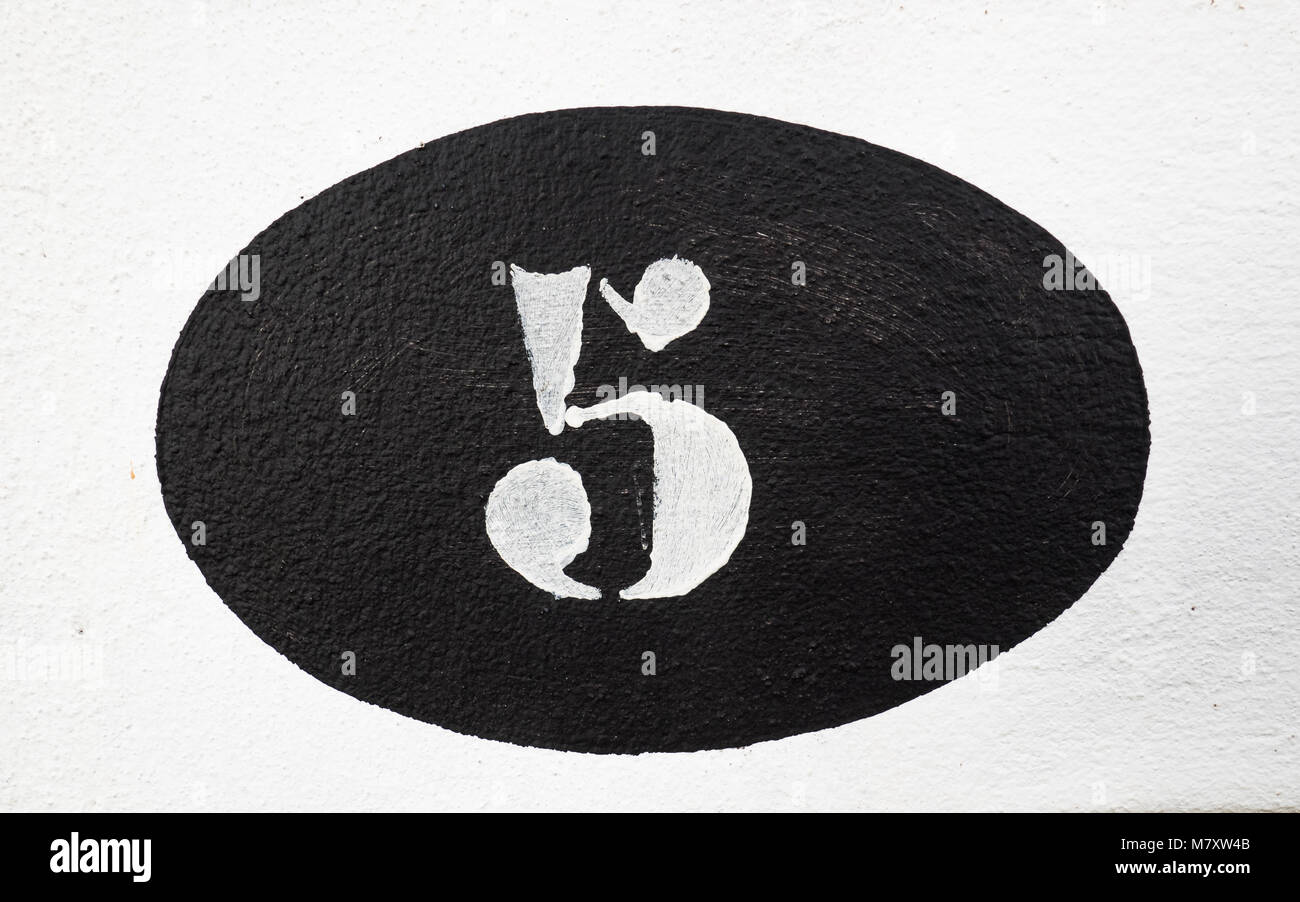 Number five painted on a wall Stock Photo