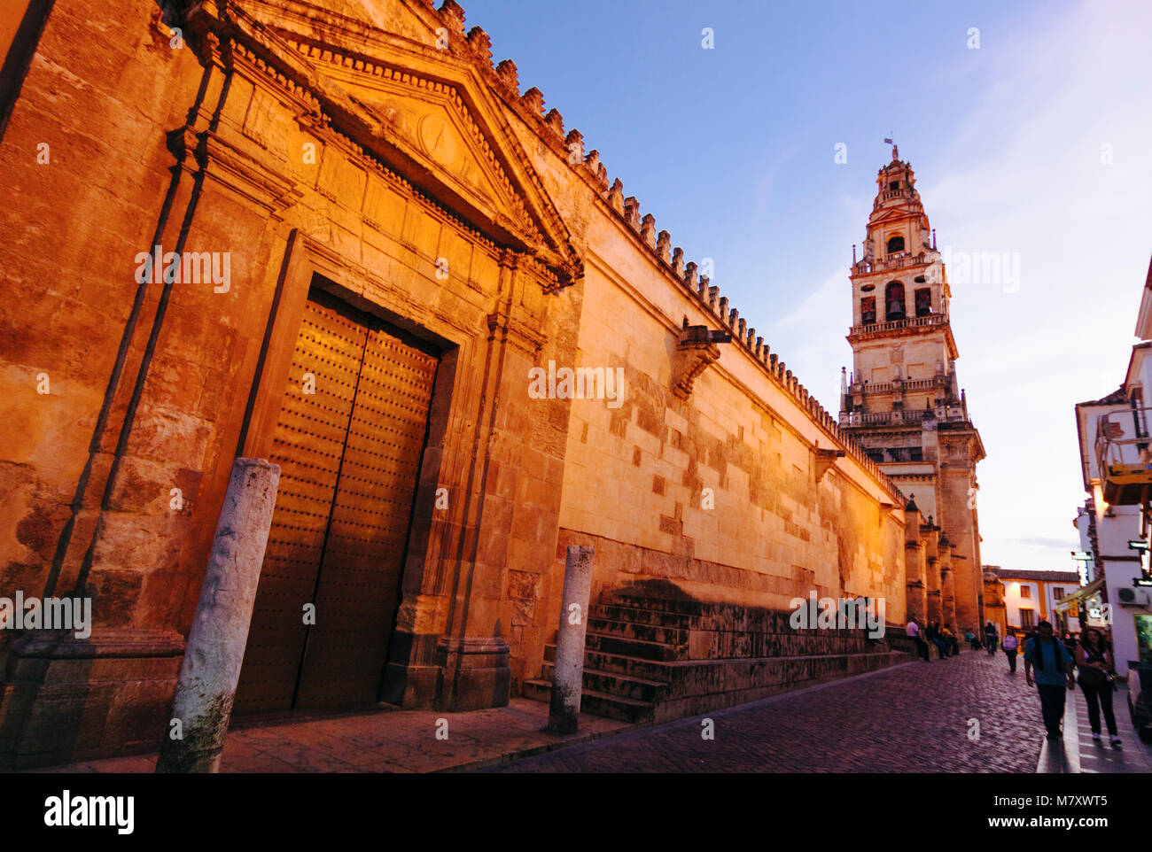 Cordoba, Andalusia, Spain : Mosque–Cathedral of Córdoba, People walk past the Puerta del Caño door in - Stock Image