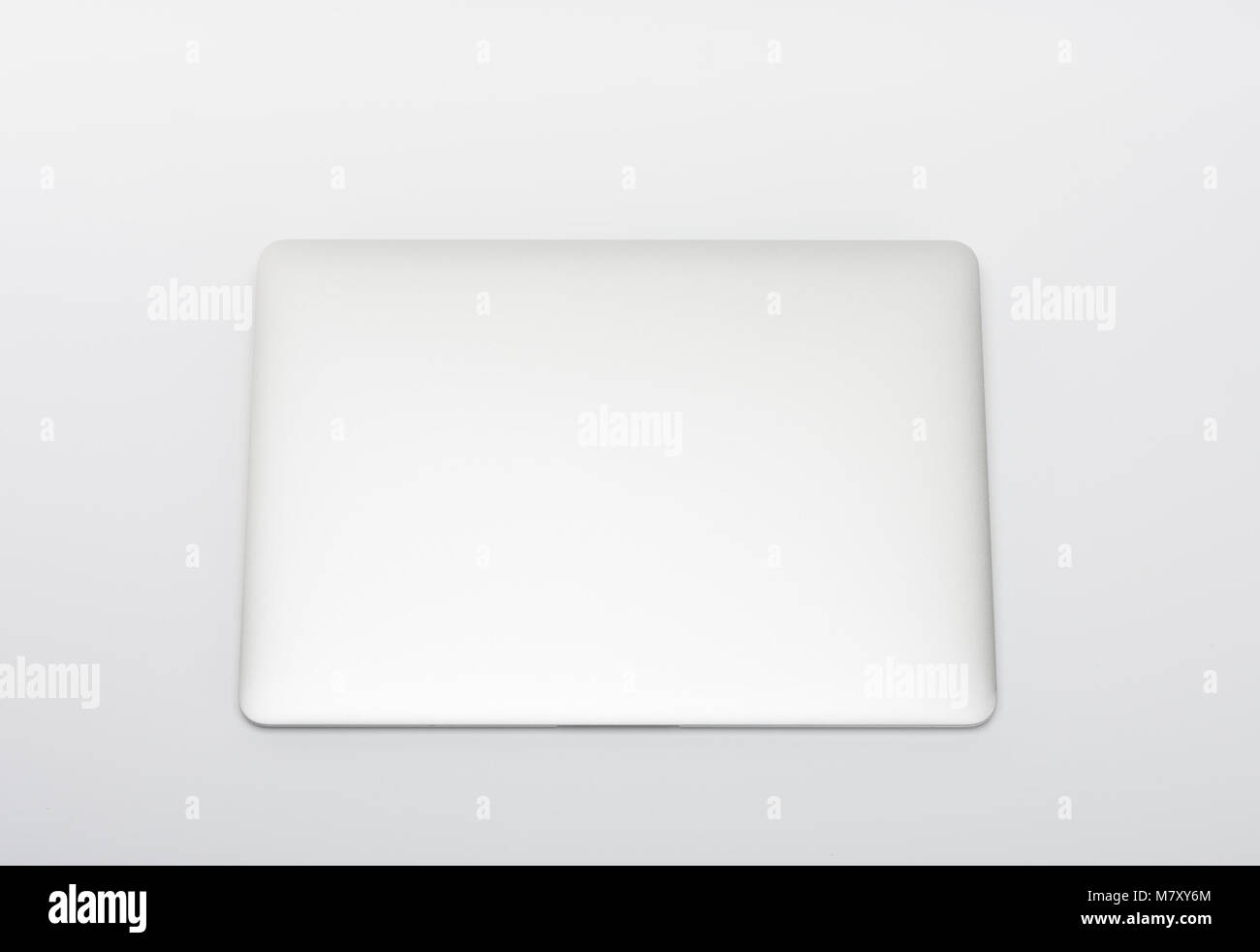 Closed  modern, new laptop on white background, top view - Stock Image