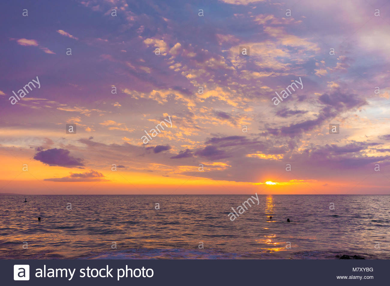 Tropical sunset from Kamaole Beach Park 3 over the Pacific Ocean on the island of Maui in the state of Hawaii USA - Stock Image