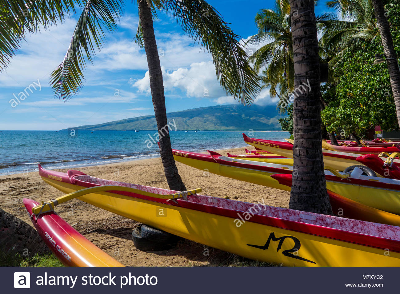Outrigger canoes on Sugar Beach at the Kihei Canoe Club in Kihei on the island of Maui in the State of Hawaii USA Stock Photo