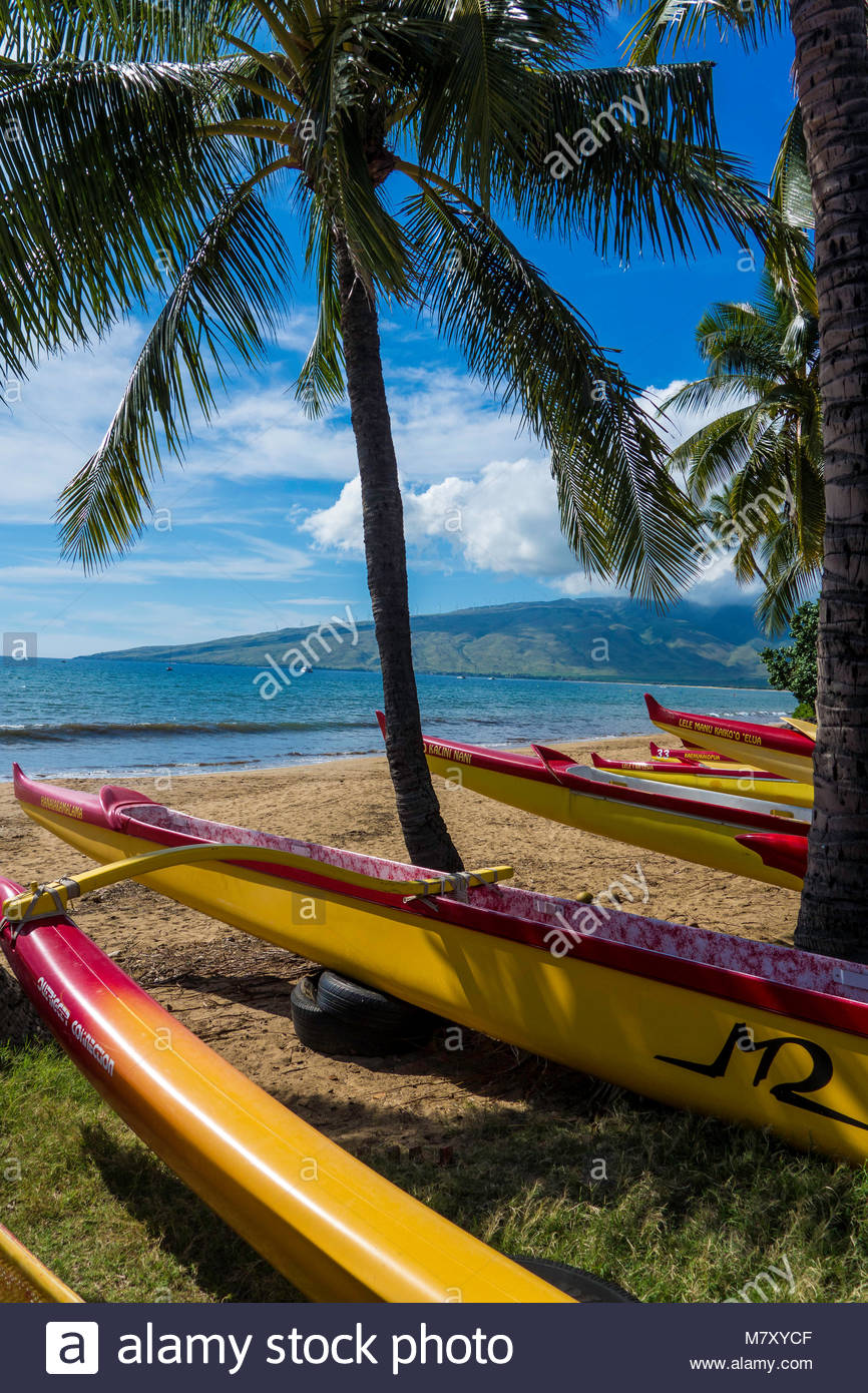 Outrigger canoes on Sugar Beach at the Kihei Canoe Club in Kihei on the island of Maui in the State of Hawaii USA - Stock Image