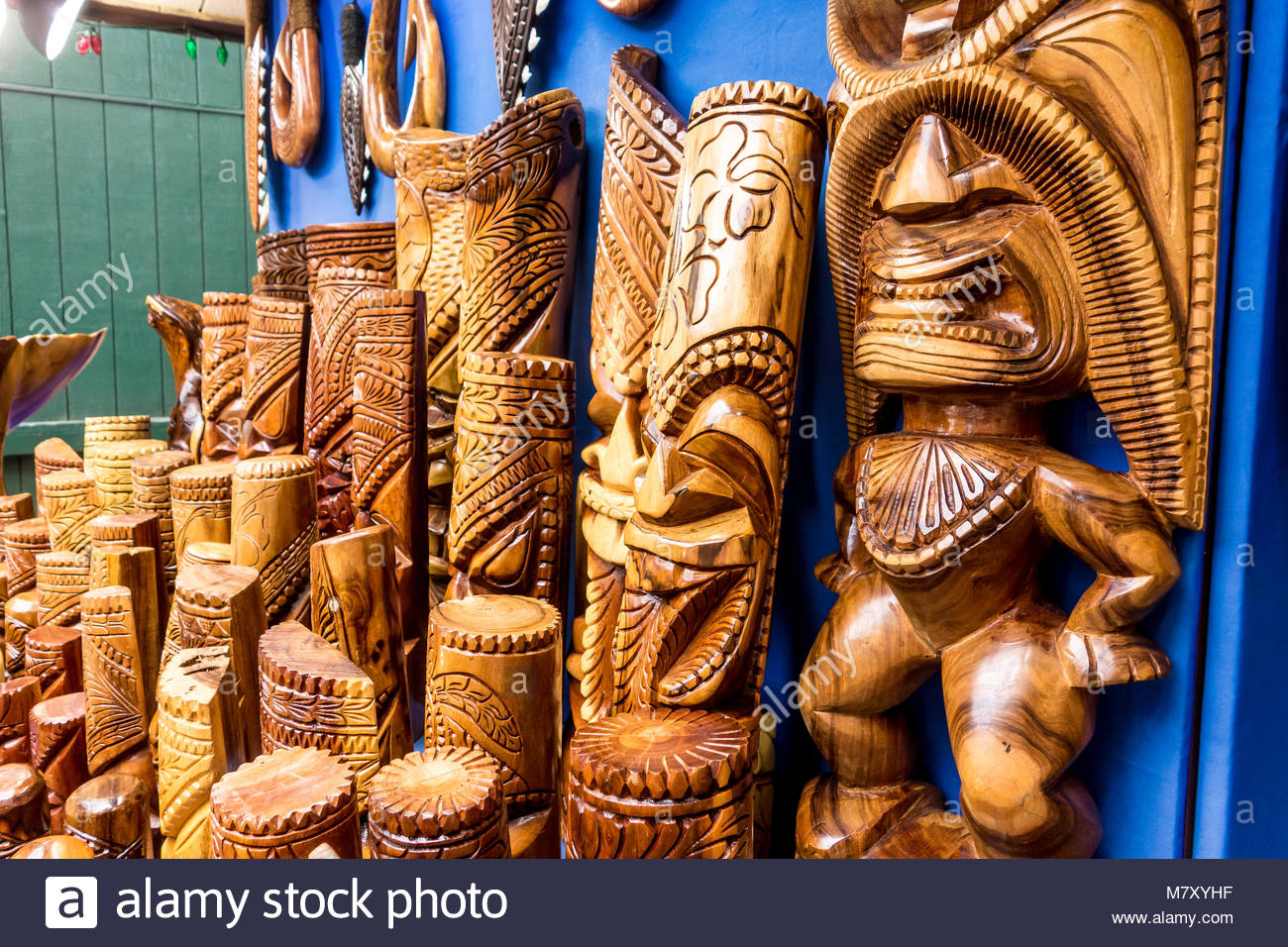 Tiki Hawaiian culture statues for sale in Lahaina on the island of Maui in the State of Hawaii USA - Stock Image