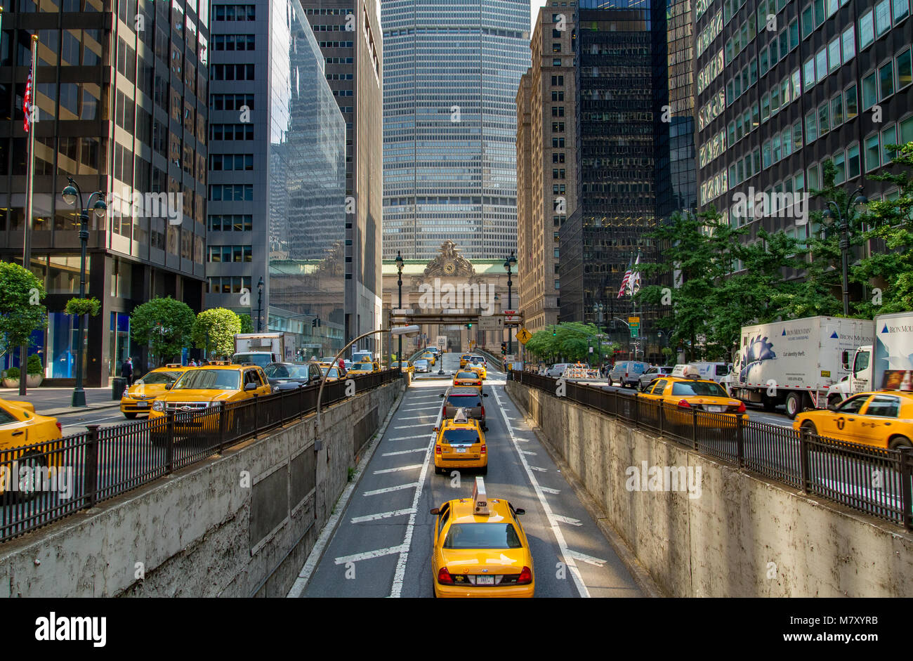 Yellow New York Taxicabs emerging from The Park Avenue Tunnel towards The Park Avenue Viaduct and  Grand Central - Stock Image
