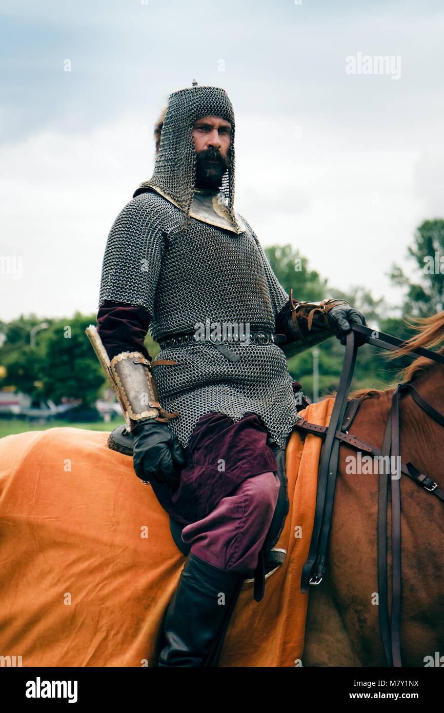 Armored companion horsemen wearing a chain mail. Battle of Klushino 1610 reenactment, Poland - Stock Image