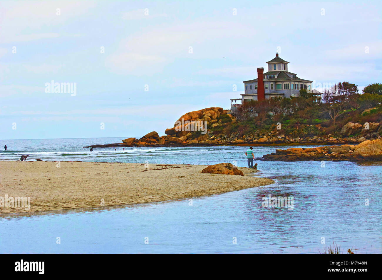 The tide shows off the rivers of water around the beach. - Stock Image