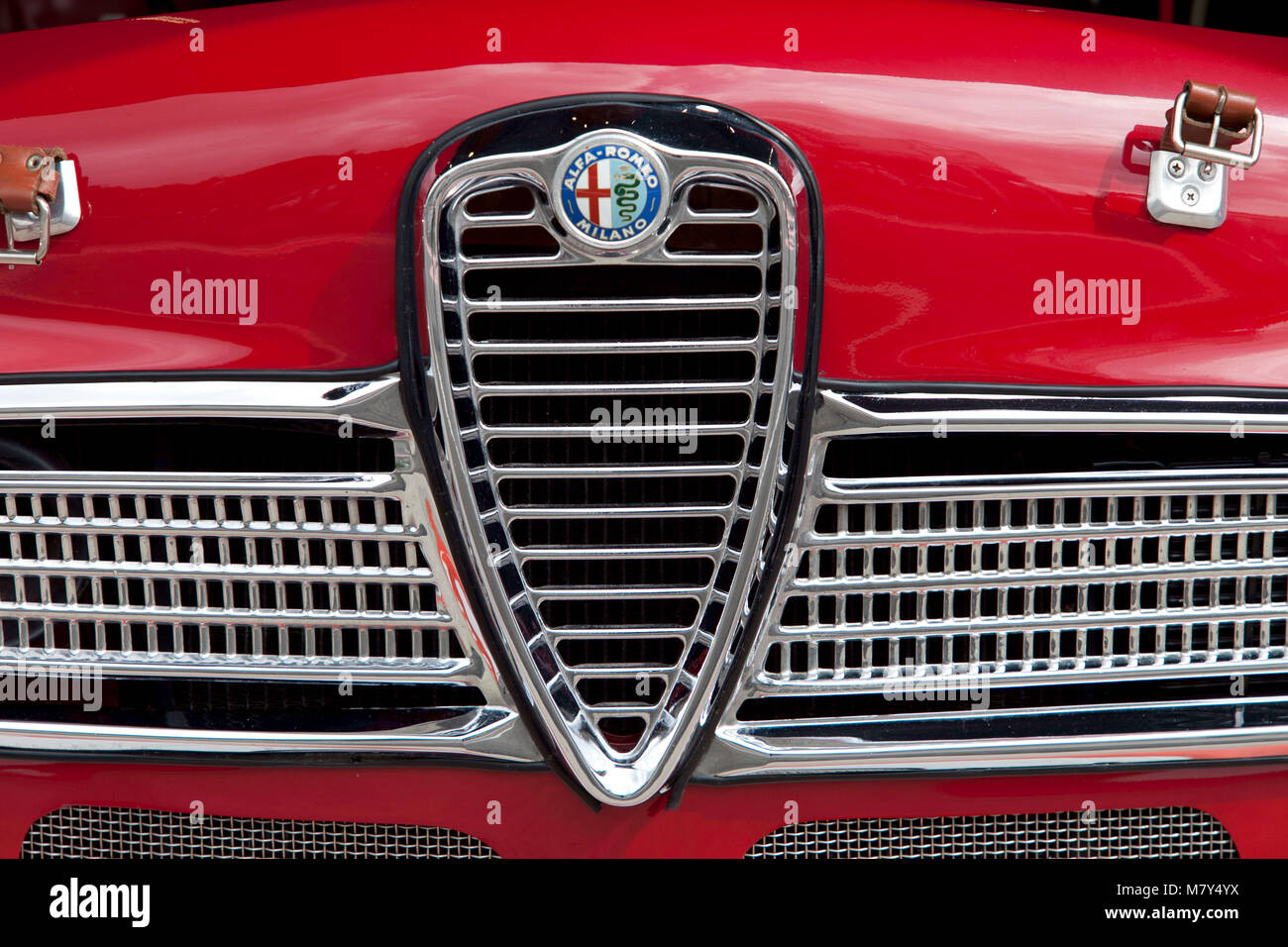1960's red Alfa Romeo front grill close up, classic car art, design [, red - Stock Image