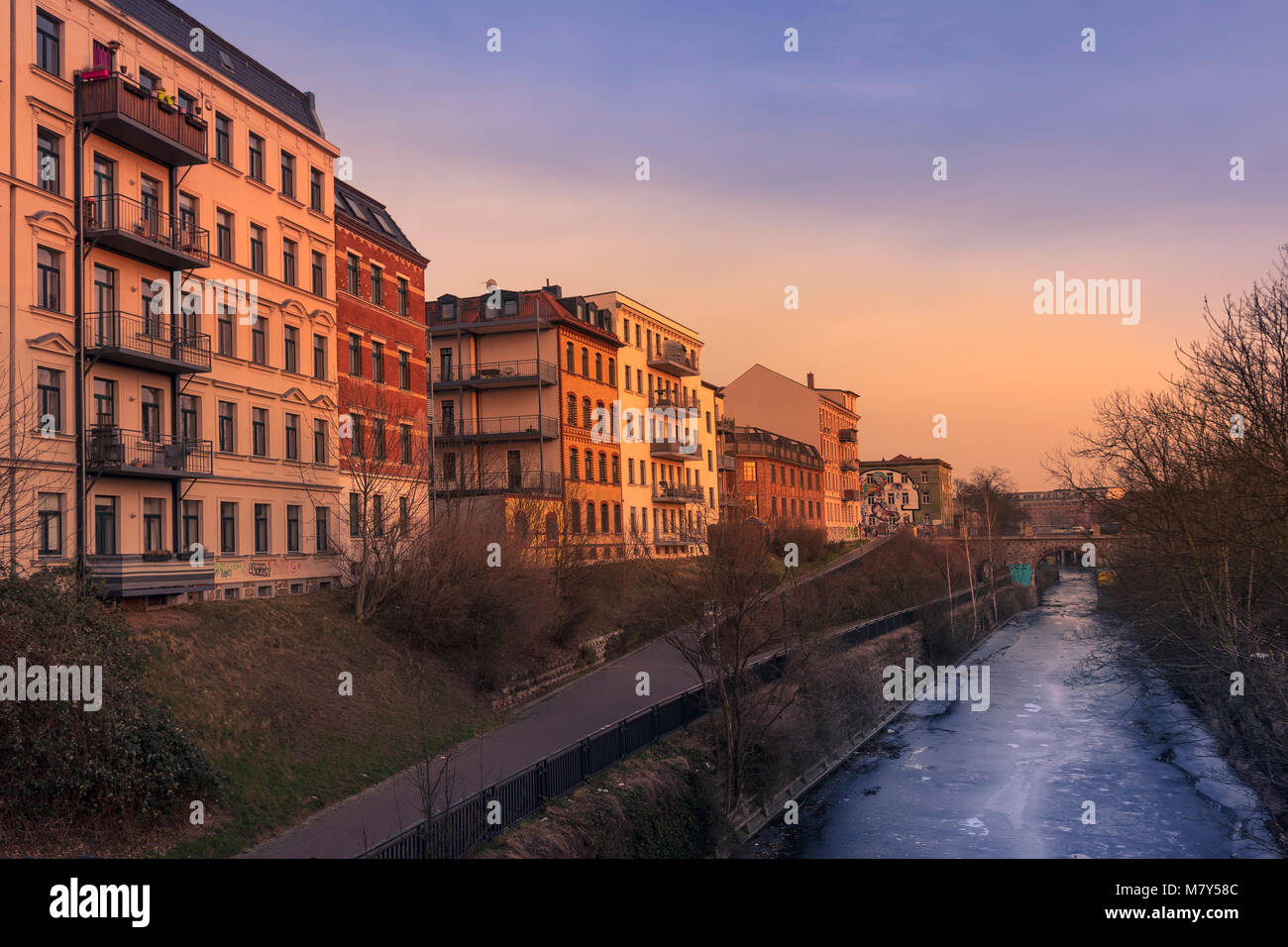 View of the Karl-Heine-Kanal at sunset, in Leipzig. - Stock Image