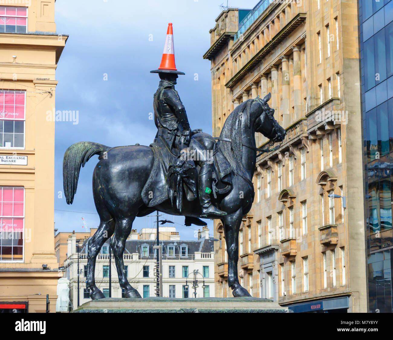 Duke of Wellington statue with a traffic cone on his head astride a horse  in front of GOMA, Royal Exchange Square, - Stock Image