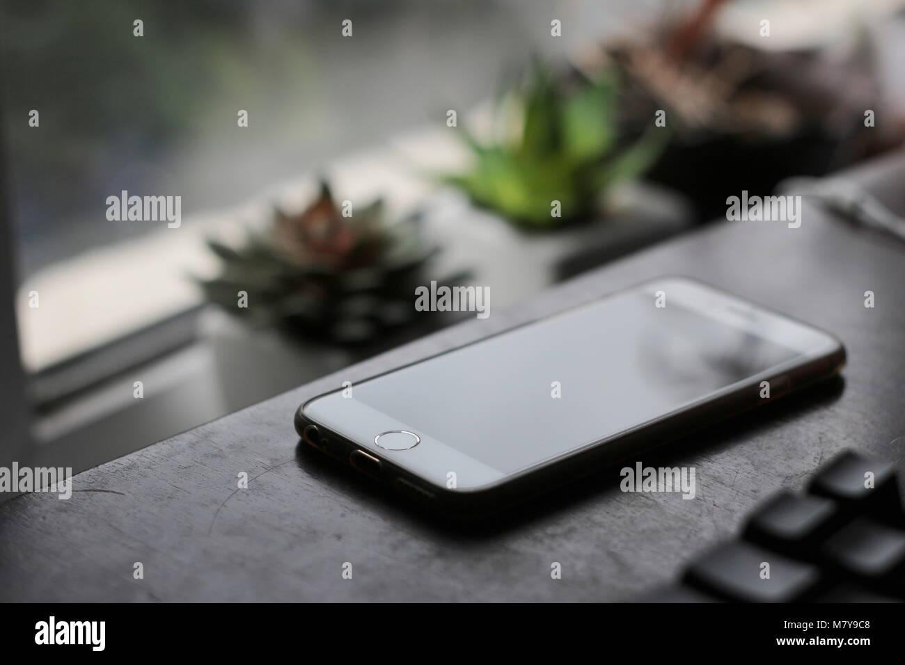 phone on desk - Stock Image