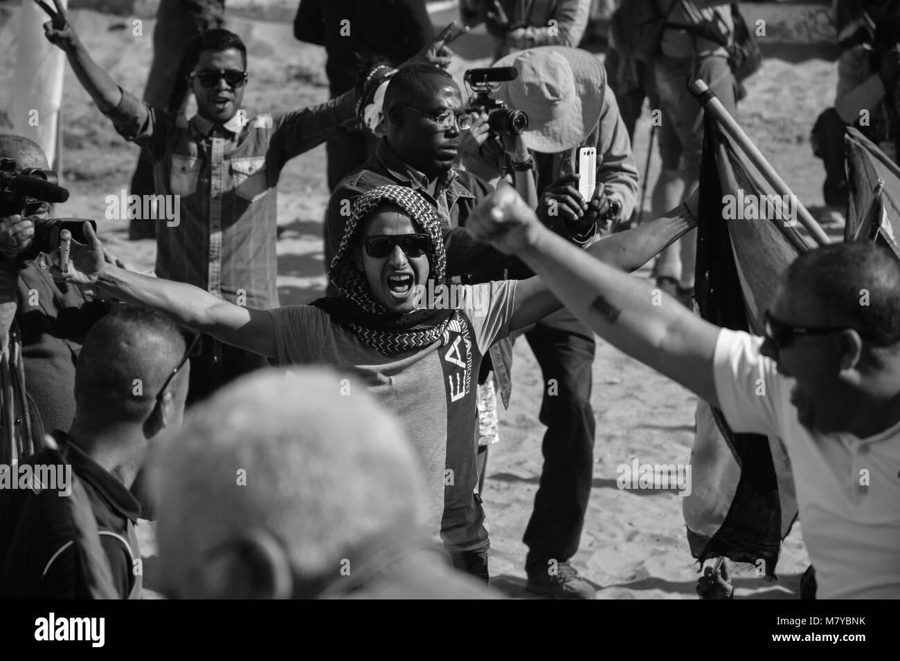 Men cebrates Sahara Marathon in Smara, Saharawi refugees camp. - Stock Image