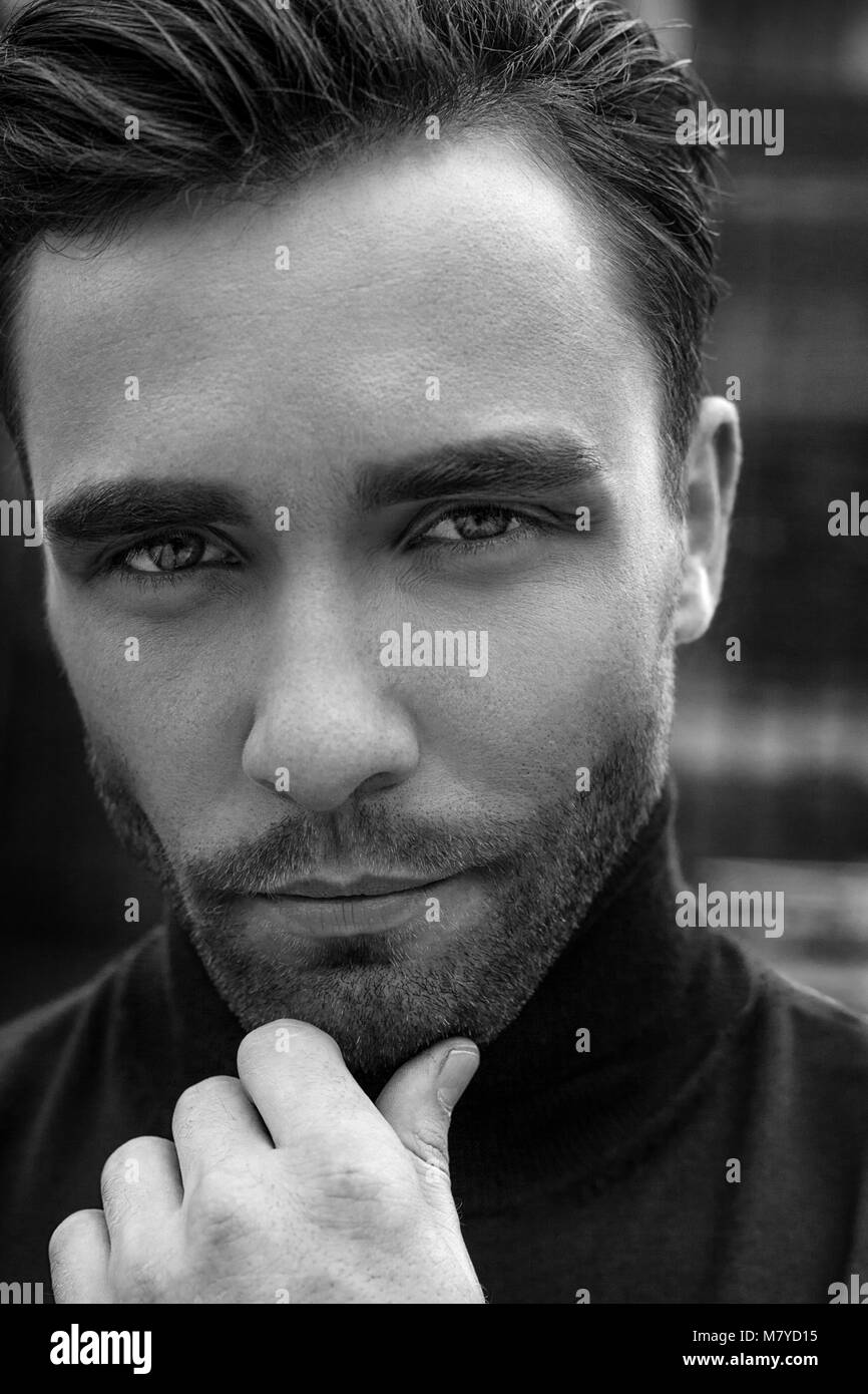Black and white handsome male model posing and looking to the camera stock image