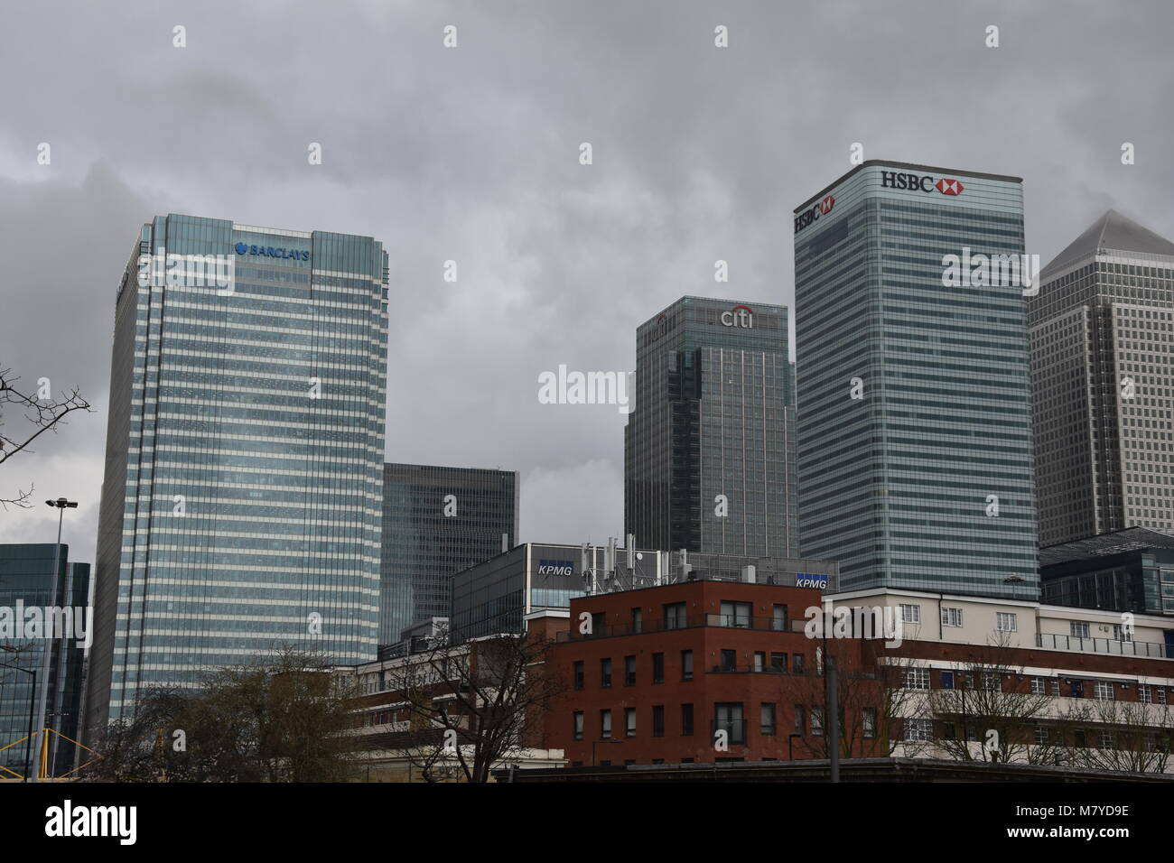 Exterior Barclays Bank HQ, plus office blocks, Canary Wharf, London - Stock Image