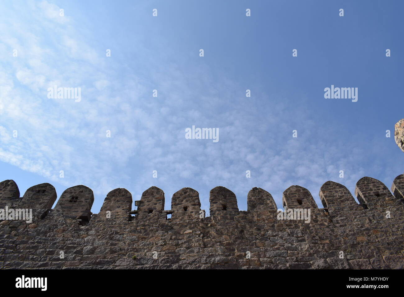 A part of the golconda fort and blue sky - Stock Image