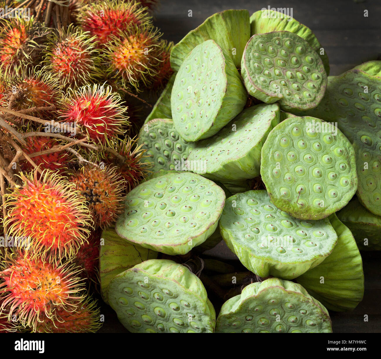 Rambutan Fruit And Lotus Flower Seed Heads On Sale In A Market