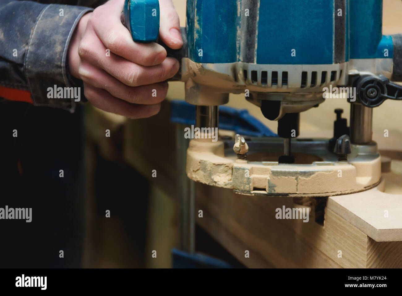 Carpenter Working of Manual Milling Machine in Carpentry Workshop with  Copyspace. Industrial Manufactoring Concept.
