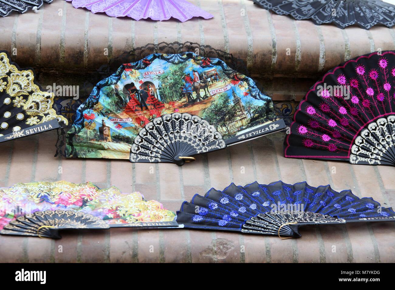 Souvenir fans on the steps of the bridge at Plaza de Espana - Stock Image