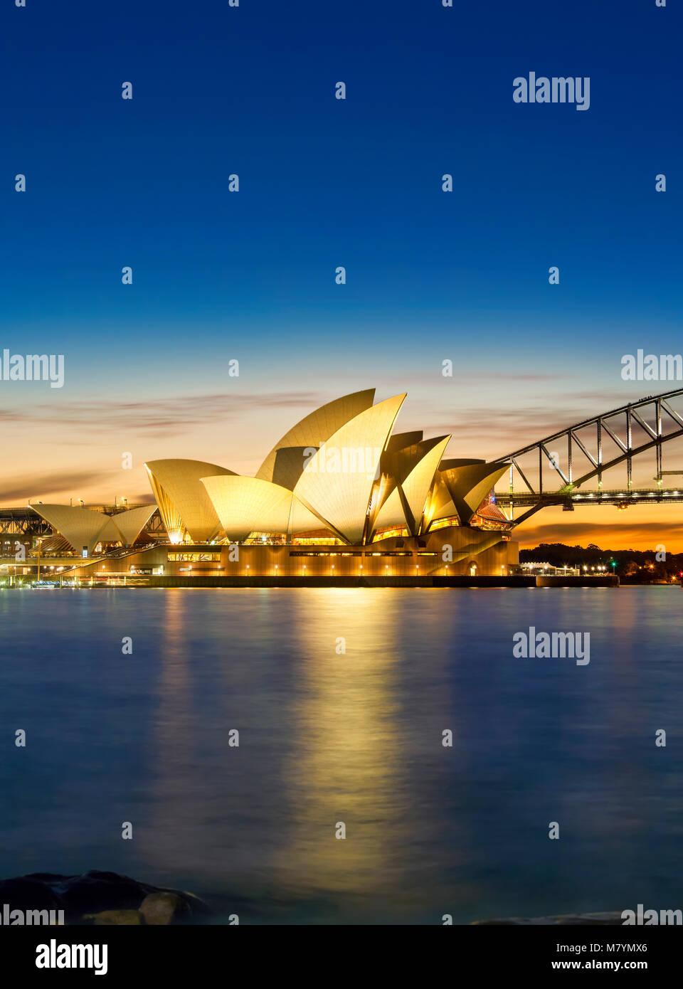 Sydney Opera House with Sydney Harbor Bridge, Sydney Harbour Bridge at sunset Sydney Australia New South Wales. Stock Photo