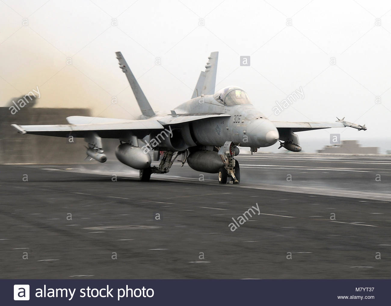 . An F/A-18C ''Hornet'' assigned to the Vigilantes of Strike Fighter Squadron (VFA) 151 is launched - Stock Image