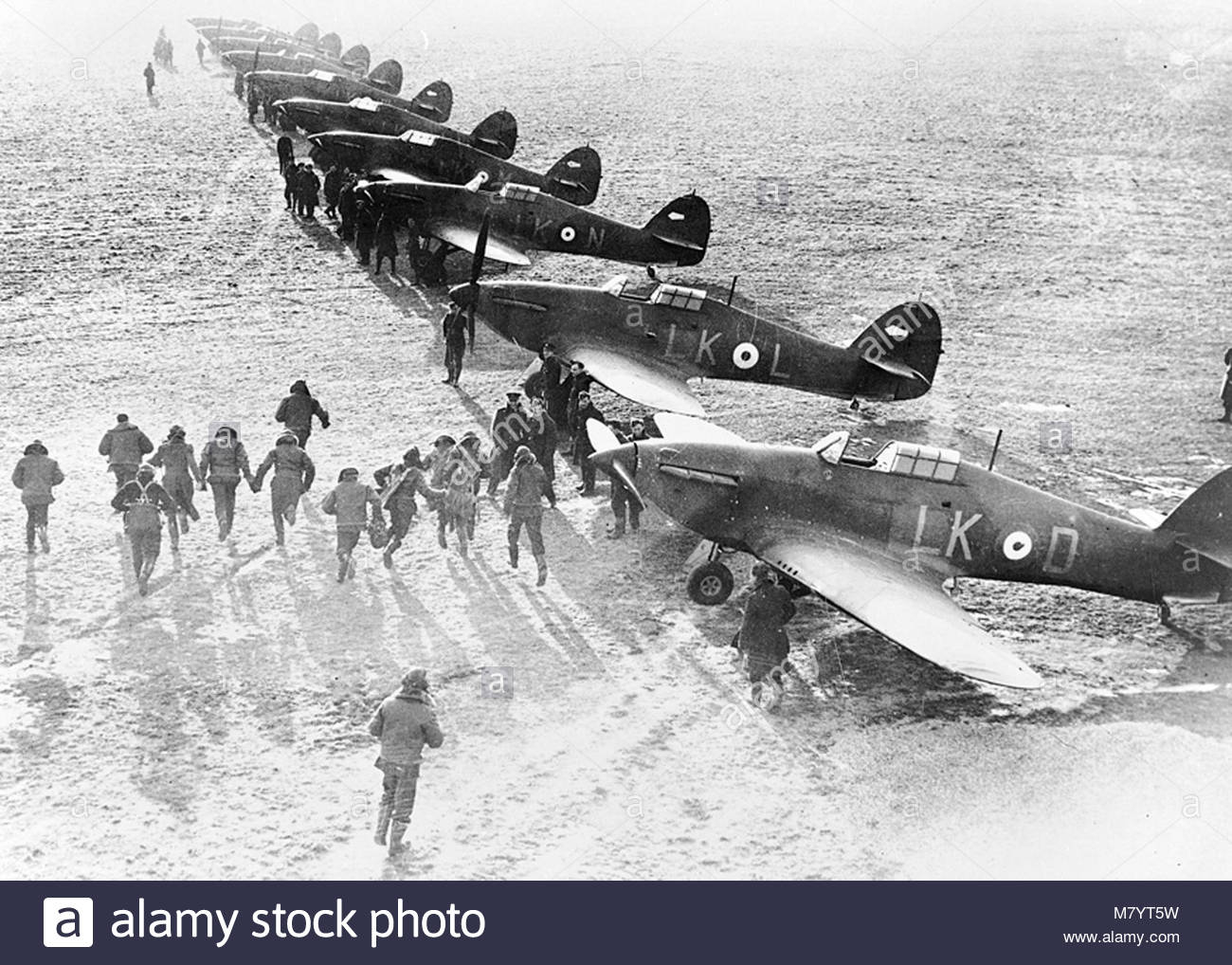 . SCRAMBLE is the command  that sends these Royal Canadian Air Force pilots in Britain racing to their Hurricanes Stock Photo