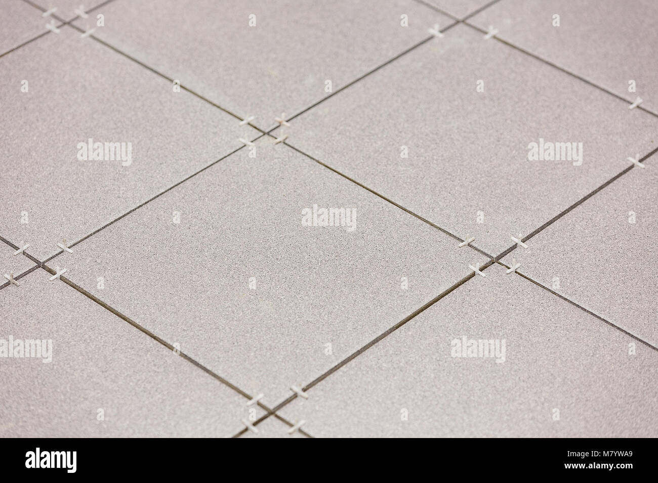 Fragment Of The Floor In The Process Of Laying Ceramic Tiles Stock