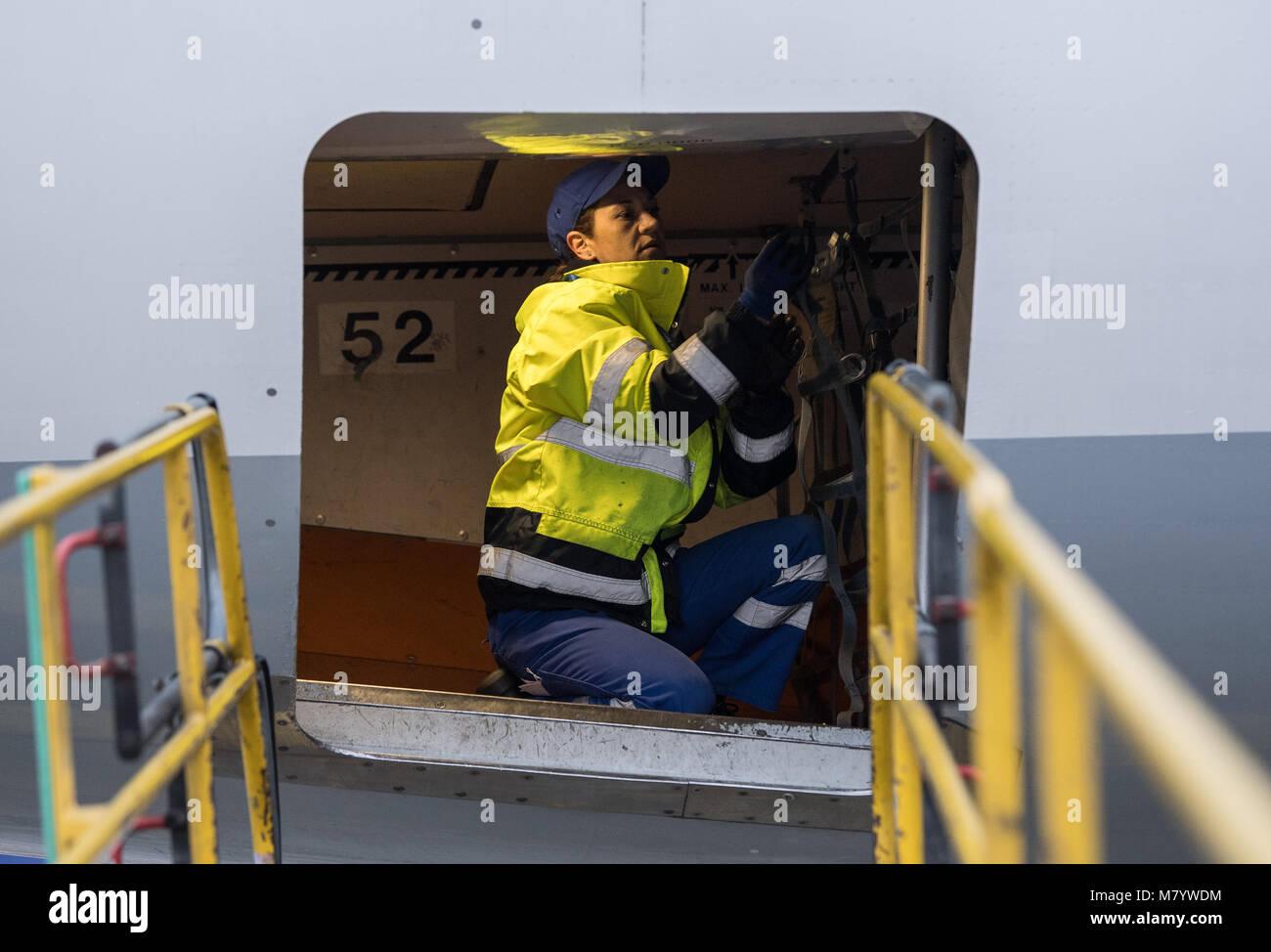08 March 2018, Germany, Frankfurt: Sevim Sejdijaj, in charge of ground handling operations,  kneels inside - Stock Image