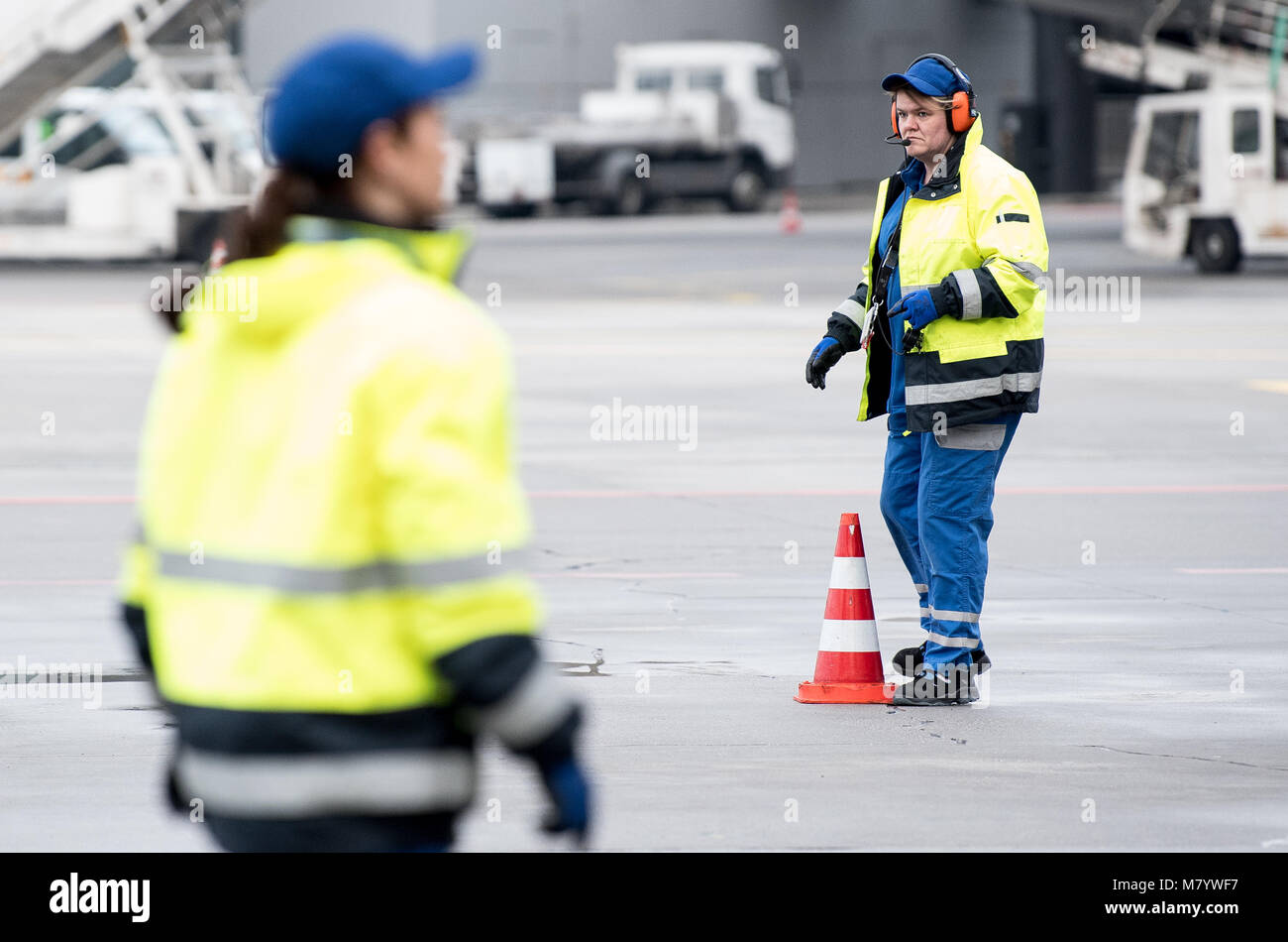08 March 2018, Germany, Frankfurt: Sevim Sejdijaj, in charge of ground handling operations, places pylons on the Stock Photo