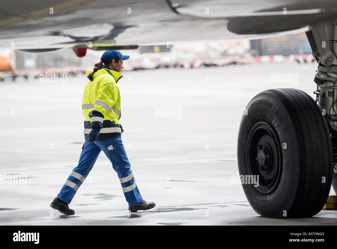 08 March 2018, Germany, Frankfurt: Sevim Sejdijaj, in charge of ground handling operations, inspects the underbody - Stock Image