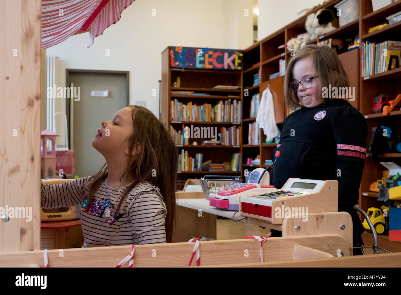 08 February 2018, Germany, Oranienburg: Nora (R), a child with Down's syndrome, and her sister Lucy play with - Stock Image