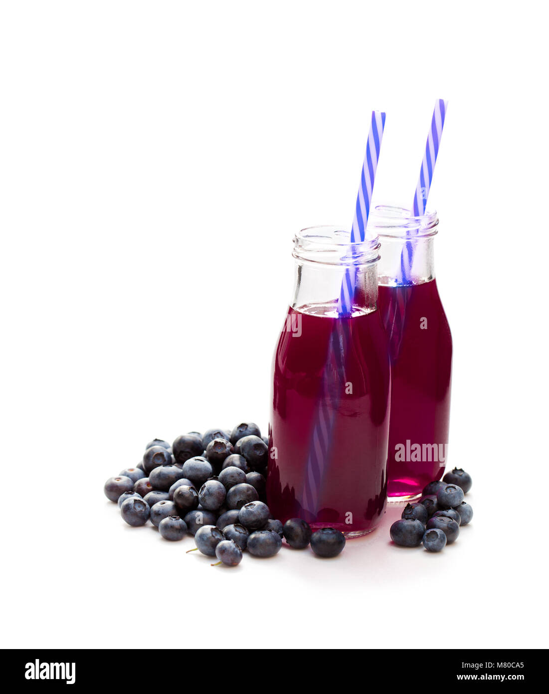 Blueberry juice in glass bottles Stock Photo: 177030621 - Alamy