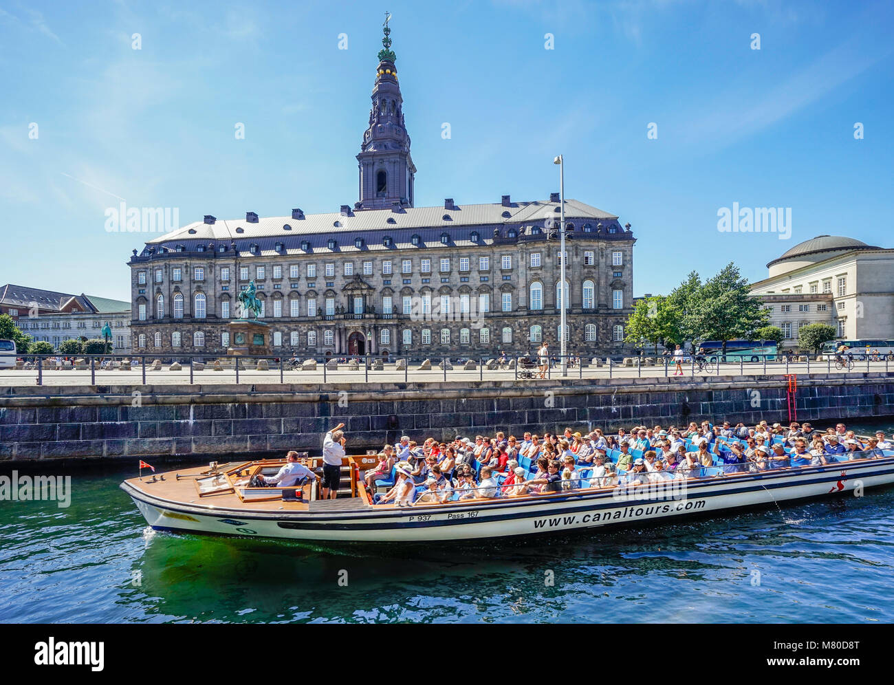 Denmark, Zealand, Copenhagen, tour boat on Slotholmens Kanal passing  Christianborg Palace, seat of the Folketinget, - Stock Image