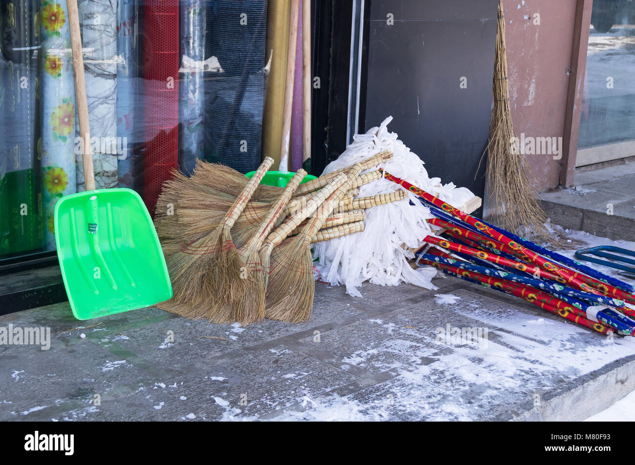 Brooms for mop shovels in the market - Stock Image