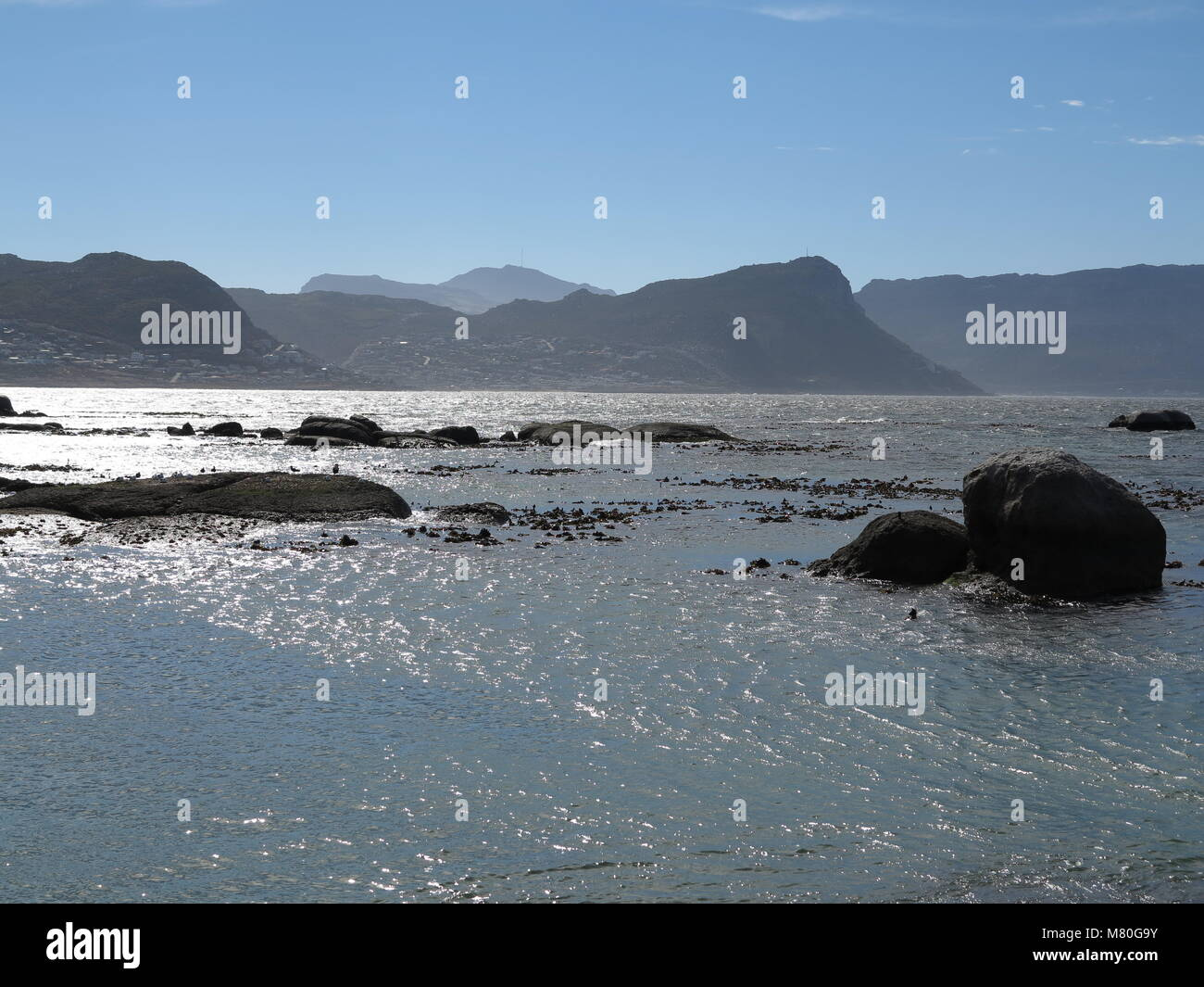 impressing costal landscape with sculptural rocks and blue water near Cape Town, South Africa - Stock Image