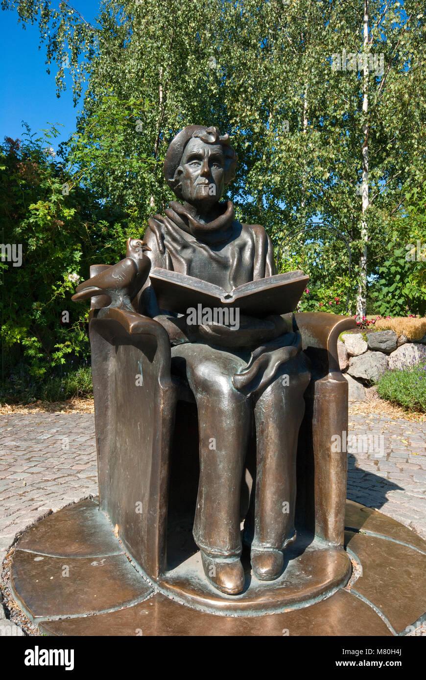 Statue of Astrid Lindgren (famous children's book author, including Pippi Longstocking) near the Junibacken - Stock Image