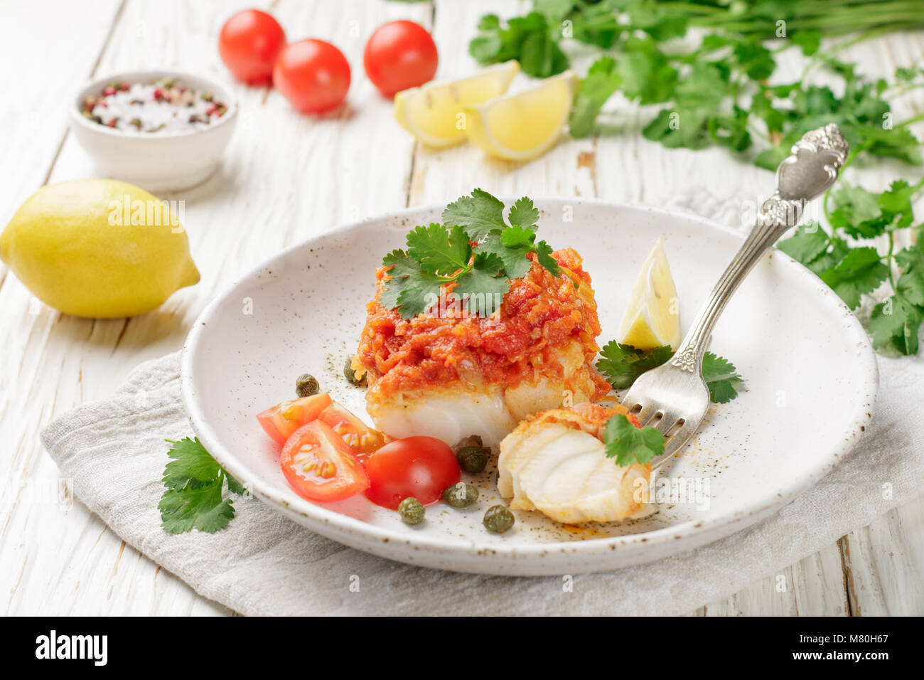 White fish (cod, Pollock, nototenia, hake), braised with onions, carrots and tomatoes. Vegetable marinade. Delicious - Stock Image
